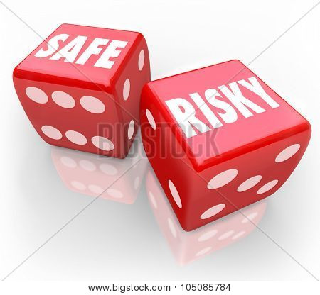 Risky Vs Safe words on dice to illustrate reduction in liability and mitigate loss or accidents