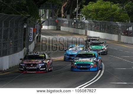KUALA LUMPUR, MALAYSIA - AUGUST 08, 2015: Turbo charged V8 supercars take part in the V8 Supercars Street Challenge at the 2015 Kuala Lumpur City Grand Prix.