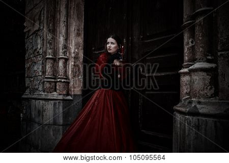 Mysterious Woman In Red Victorian Dress