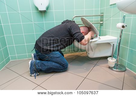 Man Vomiting In The Toilet
