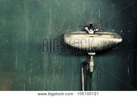 Old dirty sink in an abandoned factory.