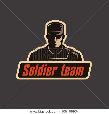 Soldier team logo template. Serious man in bulletproof vest and cap on dark background.