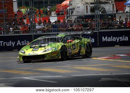 KUALA LUMPUR, MALAYSIA - AUGUST 08, 2015: Vincent Wong drives a Lamborghini Huracan Super Trofeo LP620 car takes turn 2 in the KL City GT CUP Race of the 2015 Kuala Lumpur City Grand Prix.