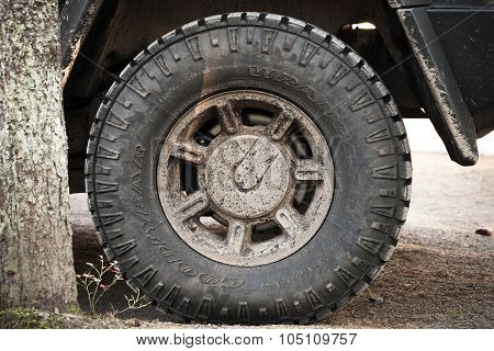Dirty Wheel With Logotype Of A Hummer H2 Car