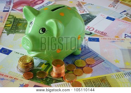 Piggy Bank On Euro Money Background