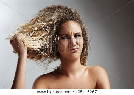Damaged Blond Hair Concept