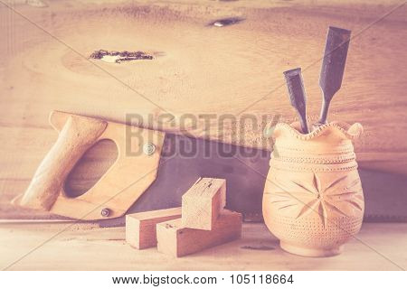 Abstract joiner tools on wood table background. made with color filtersblurred focus. poster