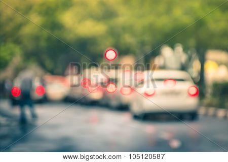 Defocused Cars In City Traffic Jam In A Rainy Day - Johannesburg Suburb Streets With Blurred Bokeh