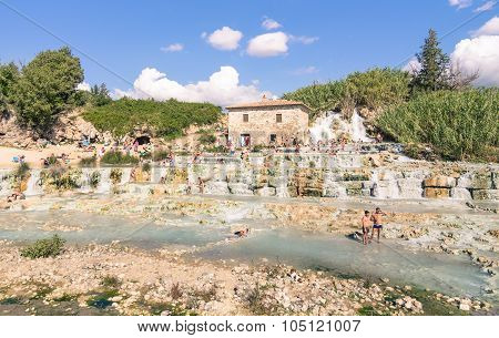International Tourists Swimming And Relaxing In Saturnia Spa