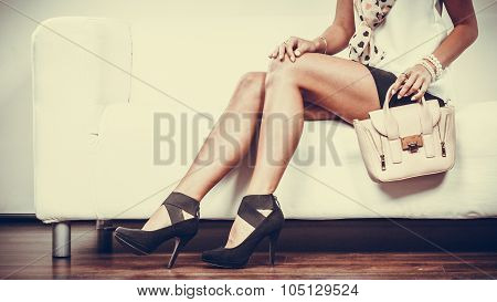 Fashionable Girl With Handbag Sitting On Sofa