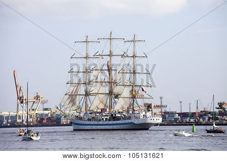 RIGA, LATVIA - JULY 28, 2013: Large sailing ship Mir leaving the port of Riga during the Regatta The Tall Ships Races 2013 Parade of sail. It is Full rigged training ship from Russia