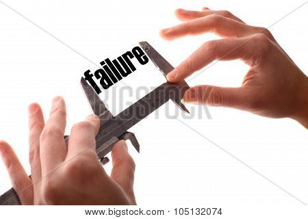 """Color horizontal shot of two hands holding a caliper and measuring the word """"failure"""". poster"""