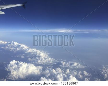 Aircraft Wing Above Clouds