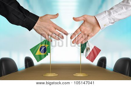 Brazil and Mexico diplomats agreeing on a deal