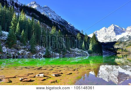 Snow Covered Maroon Bells Mountains With Colorful Yellow, Green And Red Aspen During Foliage Season