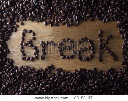 Coffee beans and the word break spelled with the coffee beans