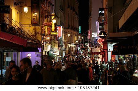 PARIS, FRANCE - SEPTEMBER 11, 2014: Latin Quarter of Paris France. Narrow street of Paris among old traditional parisian houses and cafe in Paris.