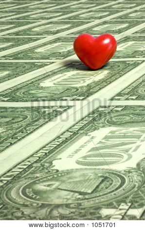 a red heart on a sea of one dollar bills. with space for copy. poster