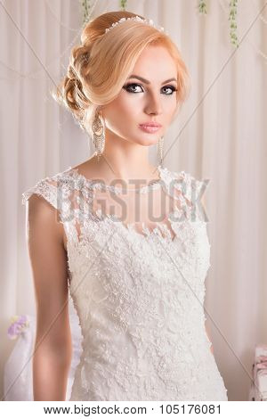 Portrait of Beautiful Bride. Beautiful bride in a wedding-dress is in fashion style. Wedding decorat