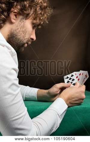man playing to green table