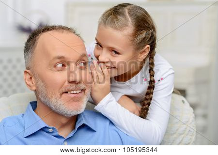 Reveal a secret. Nice vivacious grandfather telling her grandfather information secretly while relaxing together poster