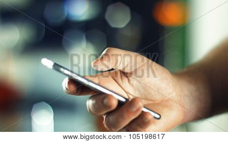 Business Man Using Mobile Phone In Office