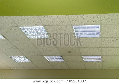 Lamps with fluorescent lights suspended ceiling and smoke detectors poster