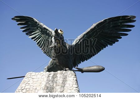 Statue Of The Famous Hungarian Legendary Turul Bird Against Blue Sky