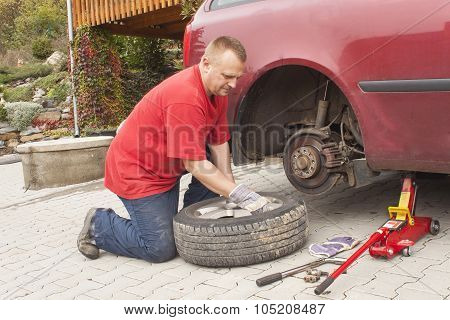 Man changing the punctured tyre