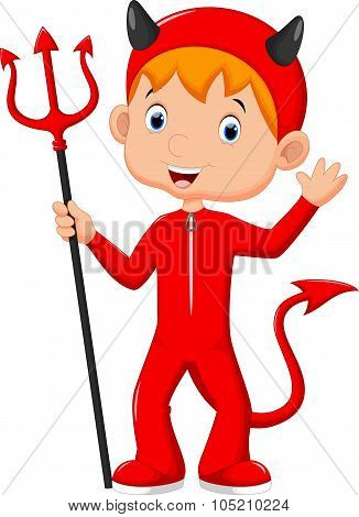 Cute little boy wearing a red devil costume