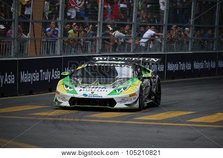 KUALA LUMPUR, MALAYSIA - AUGUST 09, 2015: Masaru Suzuki in a Lamborghini Super Trofeo LP620 car races in the Lamborghini Blancpain Super Trofeo Race at the 2015 Kuala Lumpur City Grand Prix.