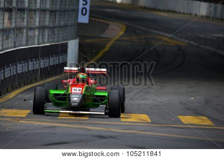 KUALA LUMPUR, MALAYSIA - AUGUST 09, 2015: William Lok in a single seater racing car race in the city street circuit in the Formula Masters China Series Race at the 2015 Kuala Lumpur City Grand Prix.
