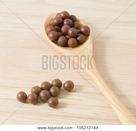 Wooden Spoon Full Of Herbal Cough Lozenges