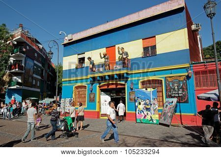 BUENOS AIRES, ARGENTINA - MARCH 27, 2011: Caminito street, La Boca, with colorfully painted buildings which is a major tourist attraction