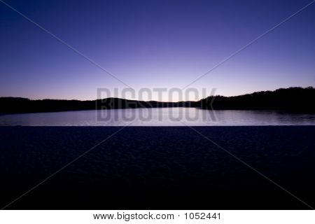 morning shot of lake mckenzie with beach in foreground poster