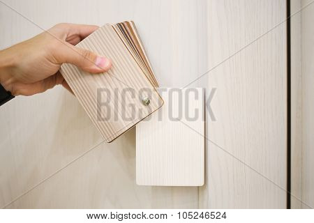 Mans hand with samples of decors for furniture