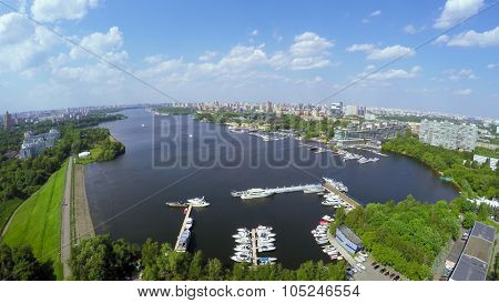 Cityscape with many yachts on moorage in city river bay at summer sunny day. Aerial view videoframe