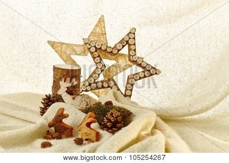 Natural christmas decoration with stars, reindeer and pineal.