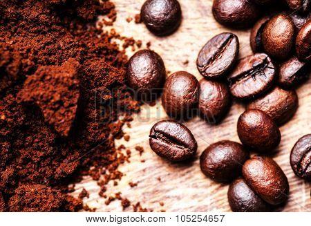 Coffee Beans On Macro Ground Coffee Background, Top View Image. Arabic Roasting Coffee - Ingredient