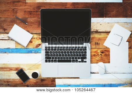 Blank Laptop On A Vintage Wooden Surface With Accessories, Mock Up