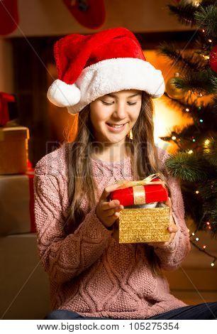 Smiling Girl Posing With Golden Christmas Gift Box