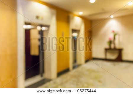 Abstract Blurred Background Of Hotel Corridor And Elevator Hall.