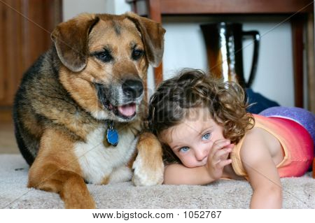 little girl and her dog laying down at the top of a staircase poster