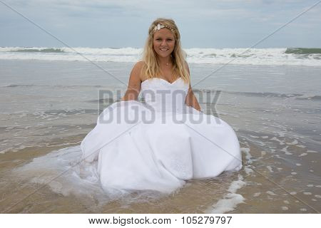 Blond Bride Woman At The Beach At Summer Time