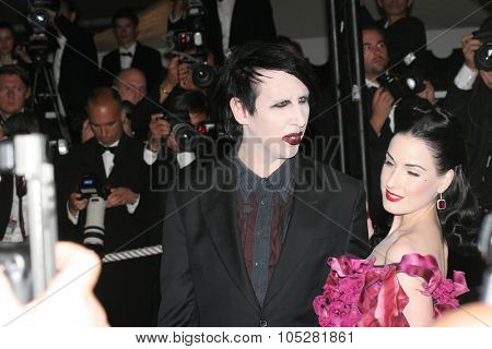 CANNES, FRANCE - MAY 21: Burlesque artist Dita von Teese and Marilyn Manson attend the 'Southland Tales' premiere at the Palais during the 59 Cannes Film Festival May 21, 2006 in Cannes, France