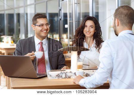 Business colleagues having friendly conversation