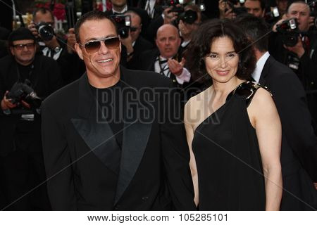 CANNES, FRANCE - MAY 12: Jean-Claude Van Damme  and Gladys Portugues attend the Premiere of 'Robin Hood' at the Palais during the 63rd  Cannes Film Festival on May 12, 2010 in Cannes, France.