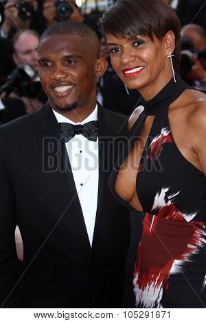 CANNES, FRANCE - MAY 16: Footballer Samuel Eto'o (L) and wife Georgette attend 'The Tree Of Life' premiere during the 64 Cannes Film Festival at Palais des Festivals on May 16, 2011 in Cannes, France