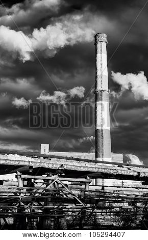 Huge Industrial Chimney And Smoke In Black And White