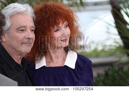 CANNES, FRANCE - MAY 21:  Sabine Azema and Pierre Arditi pose at 'Vous N'avez Encore Rien Vu' Photocall during the 65th  Cannes Film Festival at Palais des Festivals on May 21, 2012 in Cannes, France.